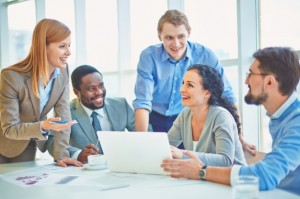 executives-joking-and-laughing-in-the-office_1098-1834