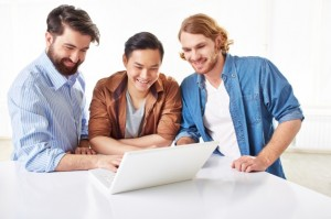 smart-businessmen-discussing-the-project-on-laptop_1098-3000